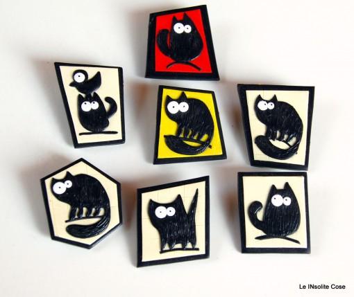 Spille con Gatti neri stilizzati – 2015