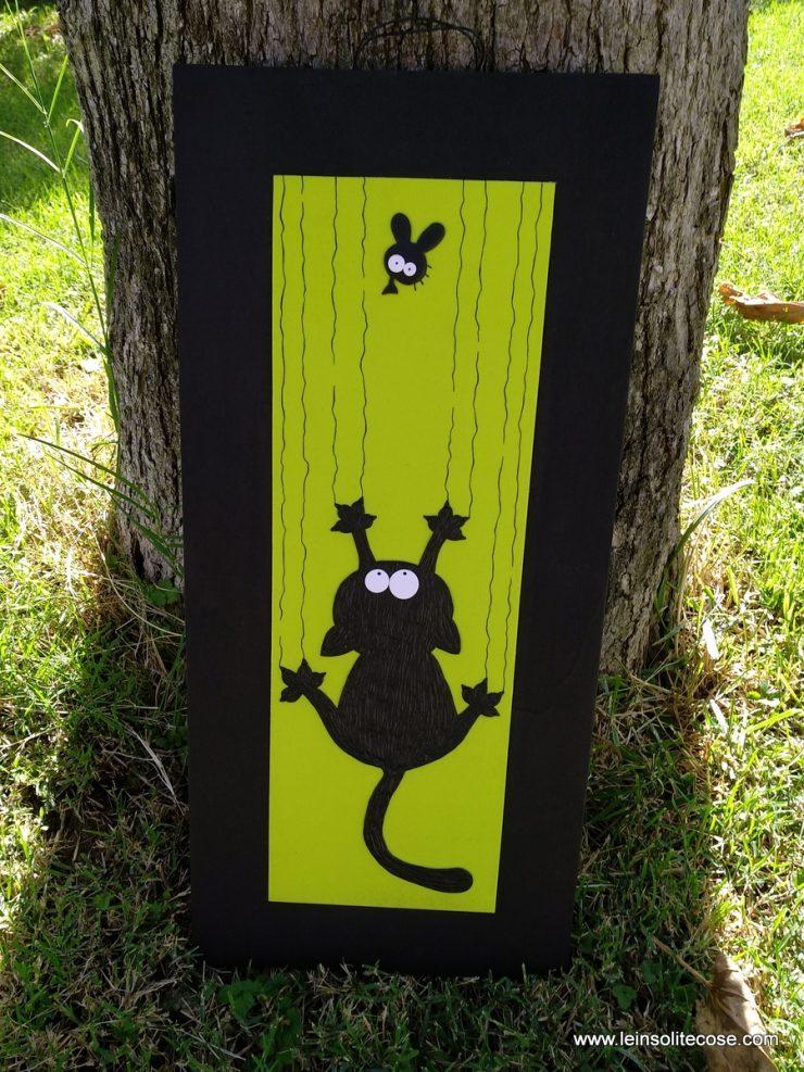 Gatto nero cade